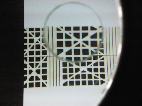 Magnifying lens used to photograph laser cut quality on thick card stock