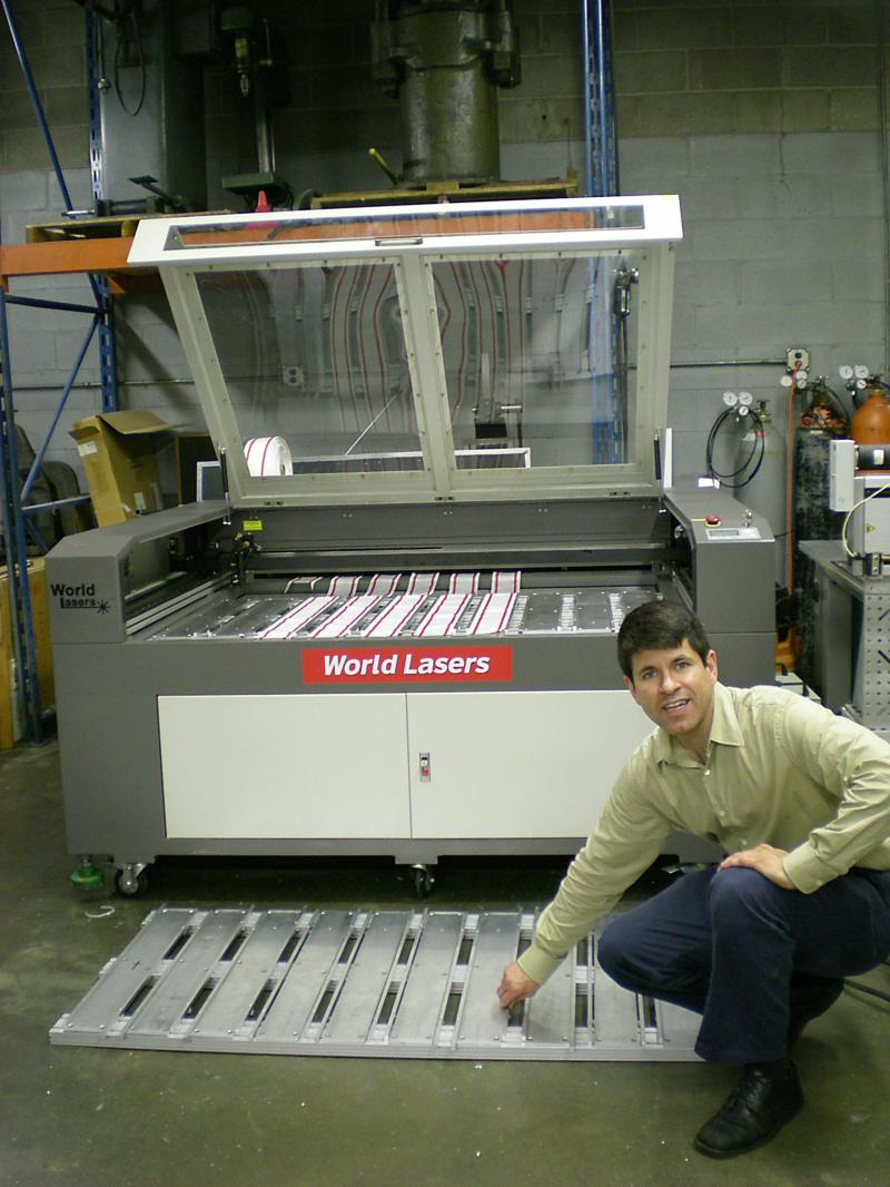 automotive webbing with two fixtures for two CO2 laser machines